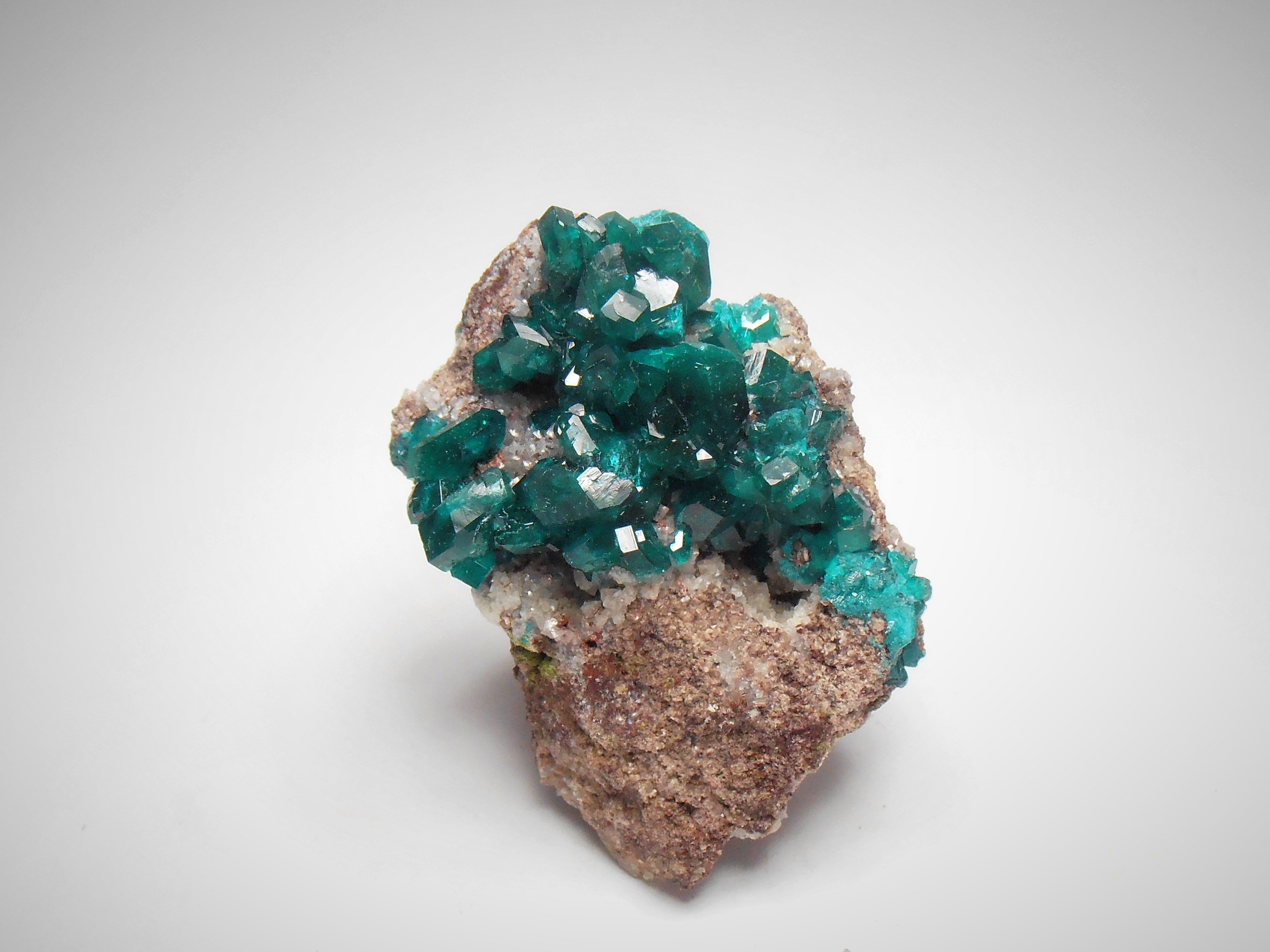 Dioptase on Calcite from the Tsumeb Mine, Tsumeb