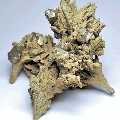Pyrite on Siderite covered Calcite from Dal'negorsk
